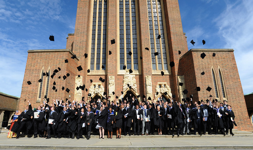 Image University-Student-Graduation-Throwing-Caps-Outside-Large-Standing-Group-Photograph  by Visual Pixel Ltd